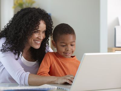 Mom and son on computer, smiling
