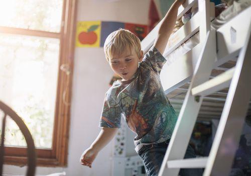 A boy plays in his bedroom