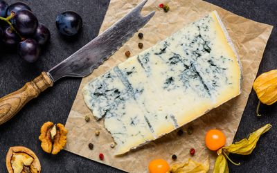 piece of blue cheese made with unpasteurized milk which could harbor listeria