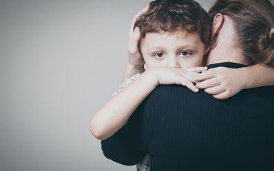 Boy hugging his mother