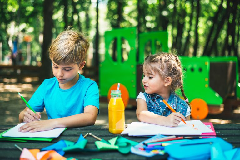 Children drawing in the park