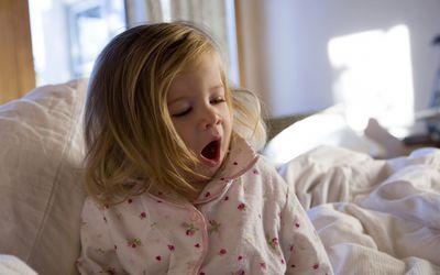 Toddler girl yawning