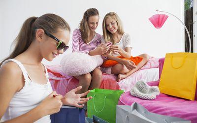Tween girls looking through gift bags