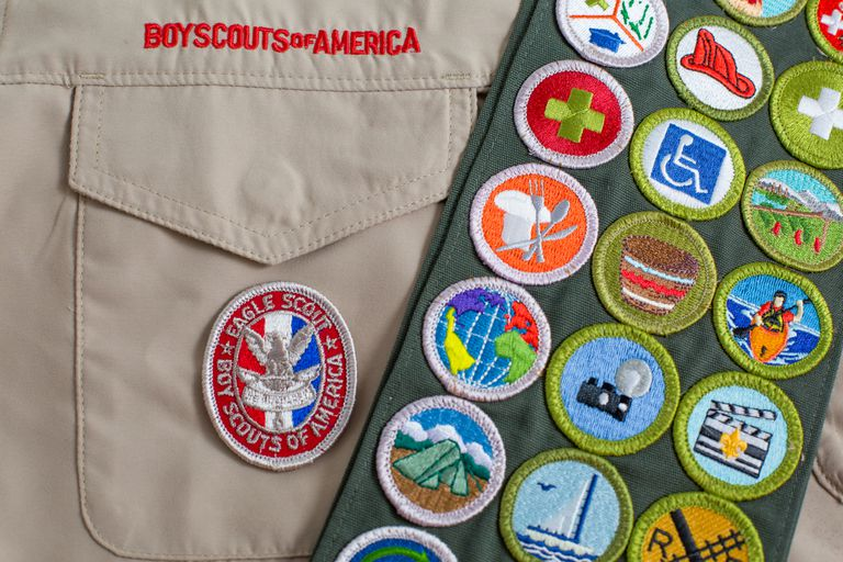 Eagle patch and merit badge sash on boy scout uniform