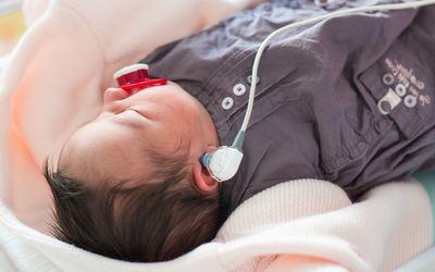 newborn baby getting hearing test in NICU