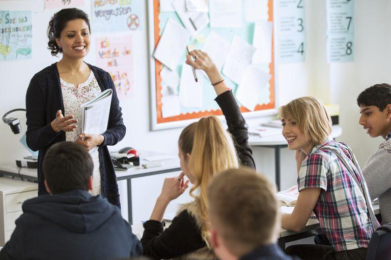 Teenage students learning in classroom