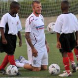 A picture of David Beckham teaching a sports clinic