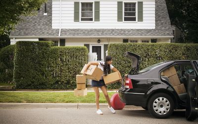 Young woman moving out