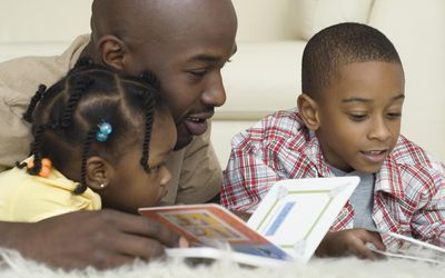 Father reading with his children