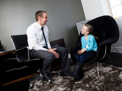 Child Psychologist talking to child before IQ testing