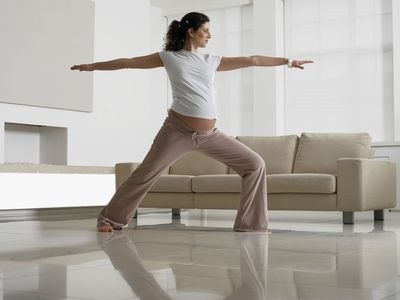 Pregnant Woman in Yoga Position in Room
