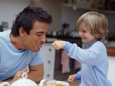 A single dad having breakfast with his son.