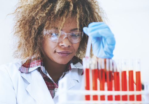 Woman in lab running a test