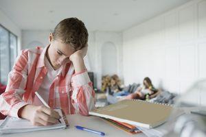 Sad boy doing homework