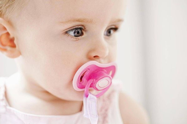 baby with pink pacifier