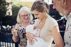 Woman holding baptized baby