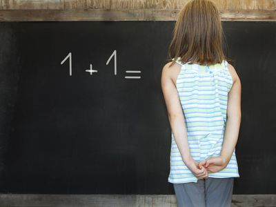 A girl struggles with a math problem.