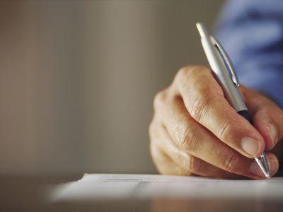 Man Signing Form