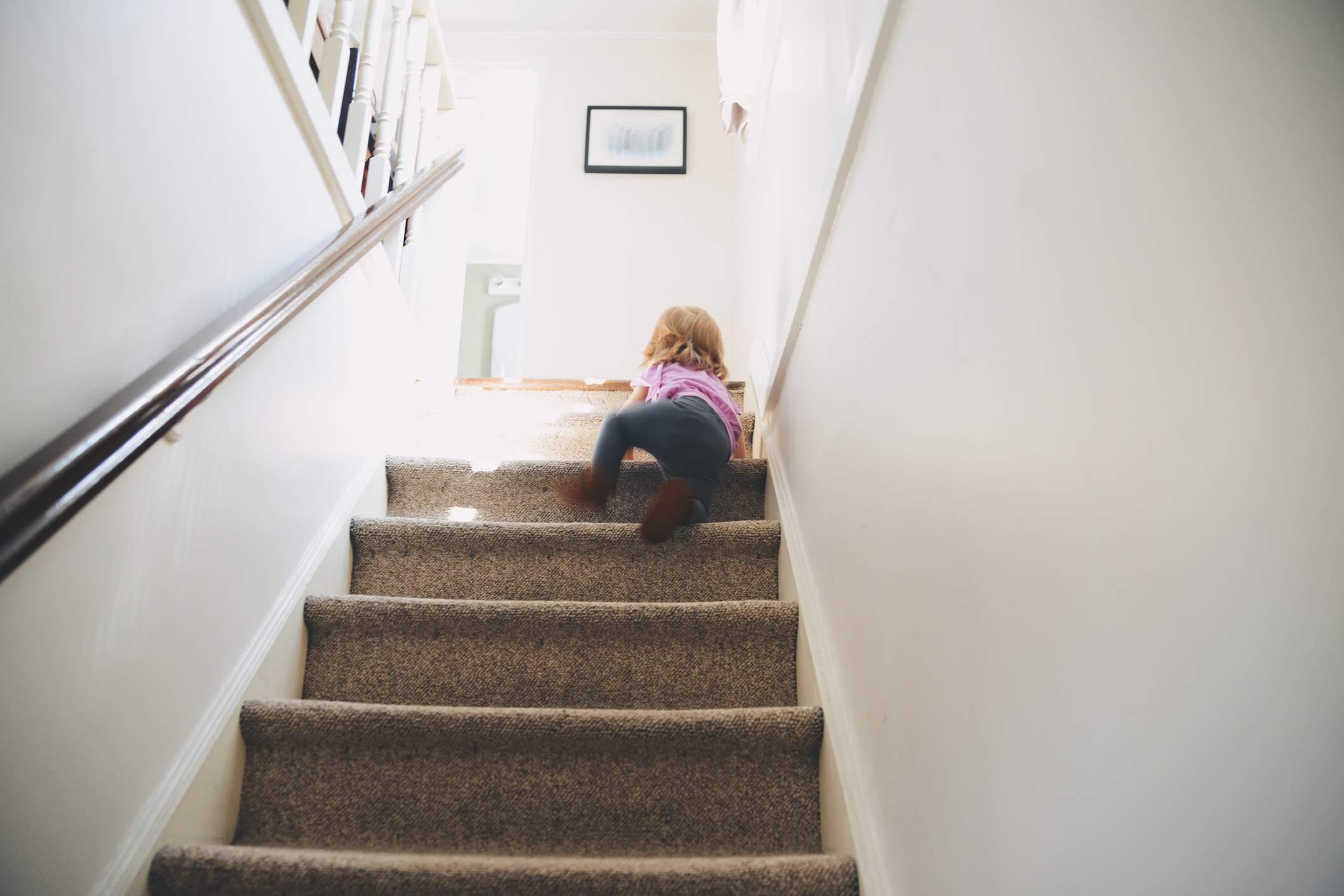 Toddler climbing stairs.