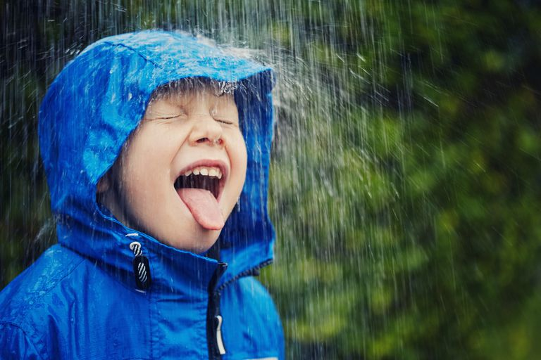 Child outdoors in the rain