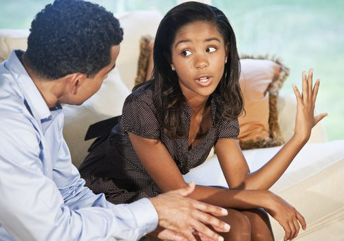 Girl talking to father