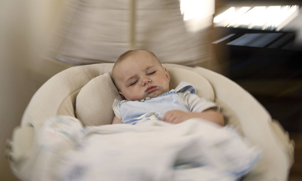 Baby in swing - stock photo