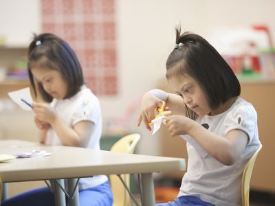 Mixed race students with Down syndrome in classroom