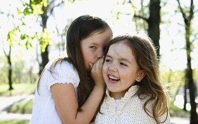 Two girls whispering