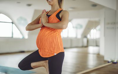 Pregnant woman in tree pose