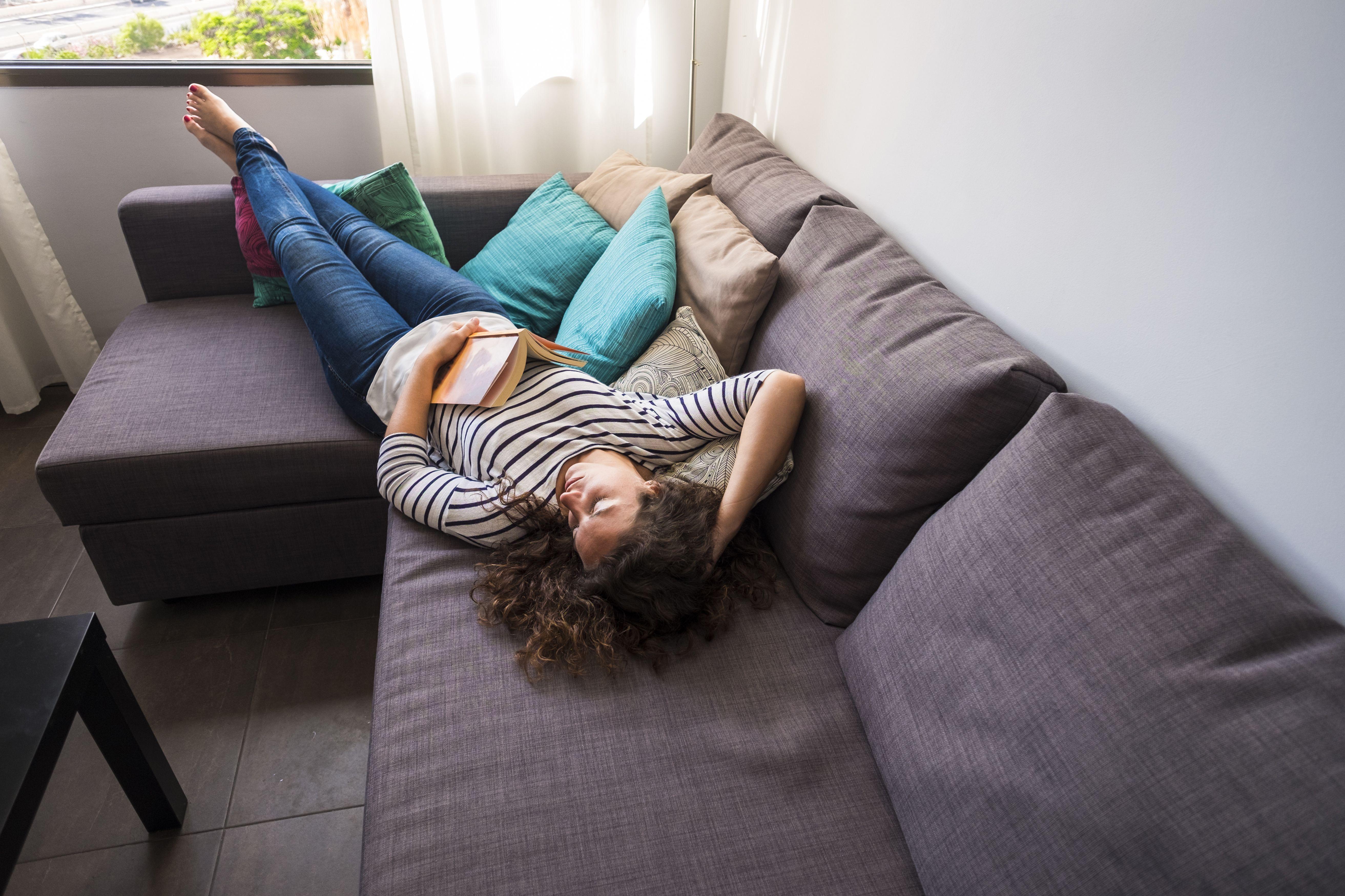 Teen sleeps on couch.