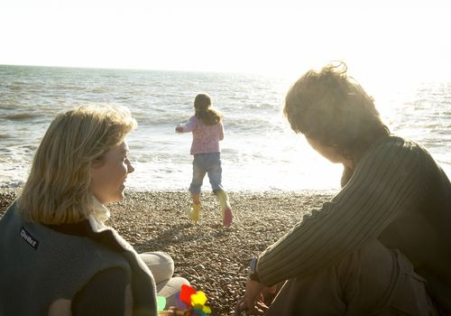 Couple on beach with child, secondary infertility preventing them from having another