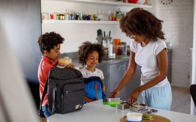 Mother packing lunch for her two children