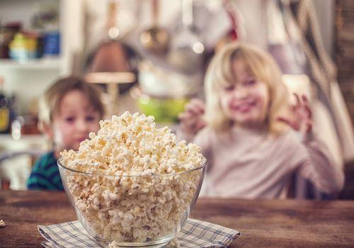 Daughters eating popcorn