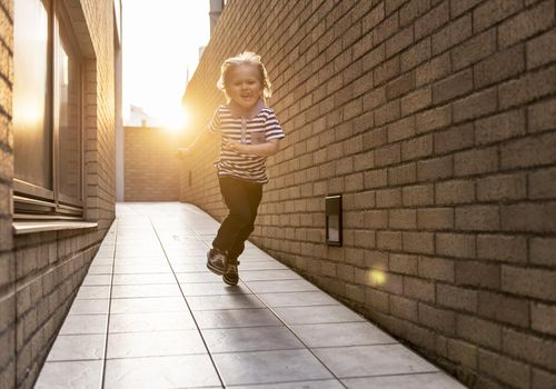a child running down a walkway