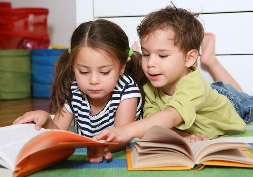 Boy and girl twins reading books