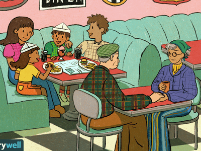 Older couple sitting next to a young family