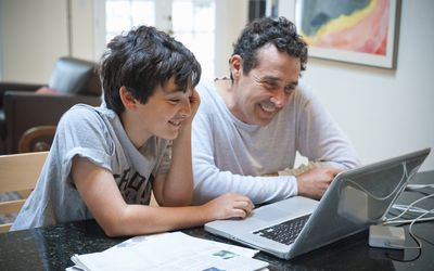 science fair project terms, father and son smiling, computer