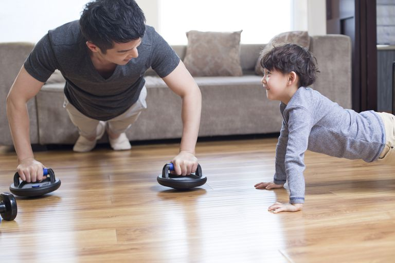 Time to work out - father and son exercise together