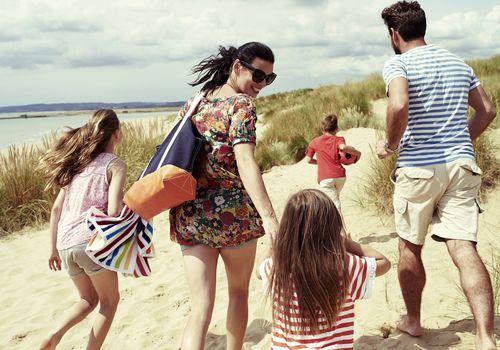 family heading to the beach