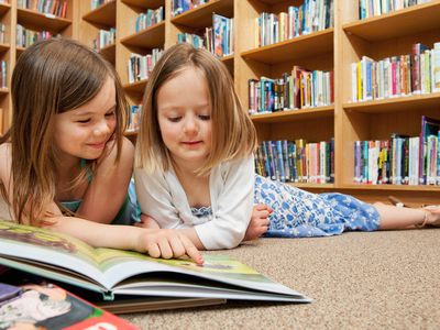 Girls reading in a school library.