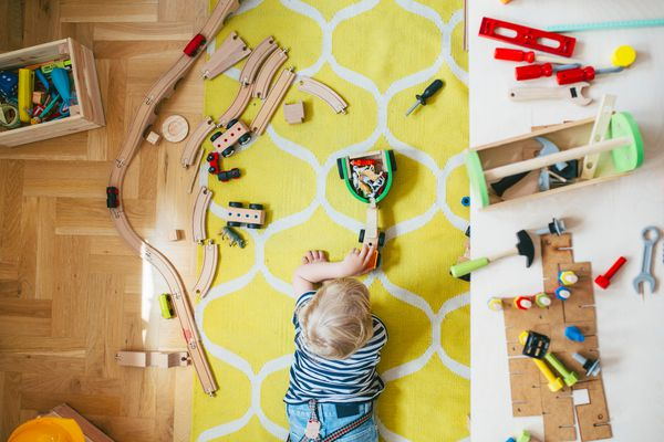 Young boy playing with toy trains