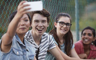 Friends making selfie outside school