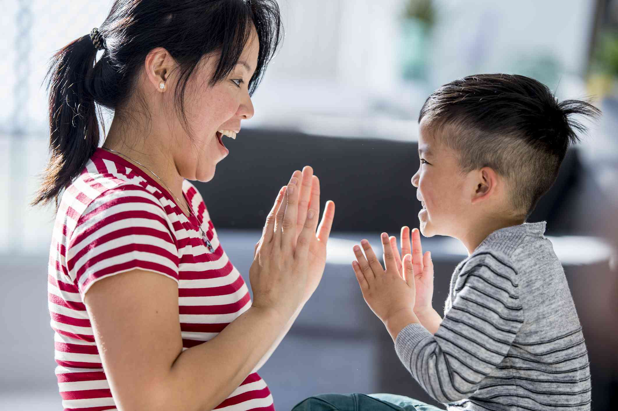 Mother and son playing clapping game