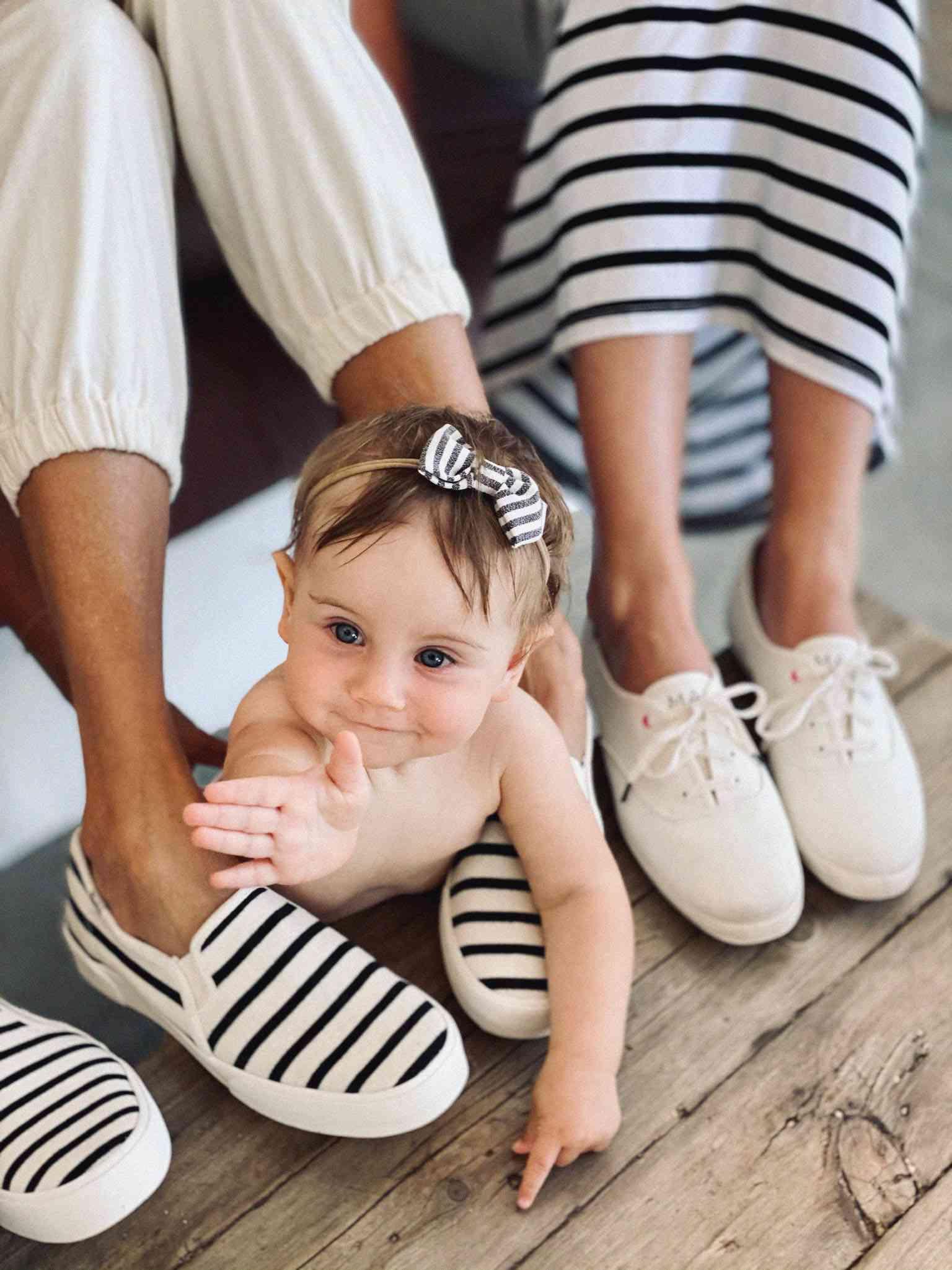 baby crawling between mother's legs