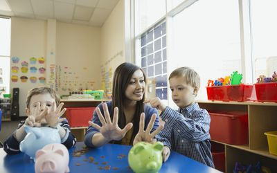 Teacher working with young students