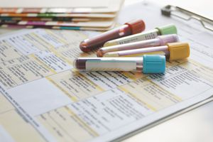Blood samples sitting on a test order form