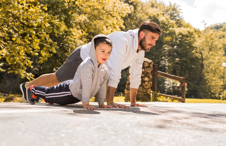 Father and son doing pushups