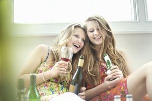 Teenage girls drinking alcohol together