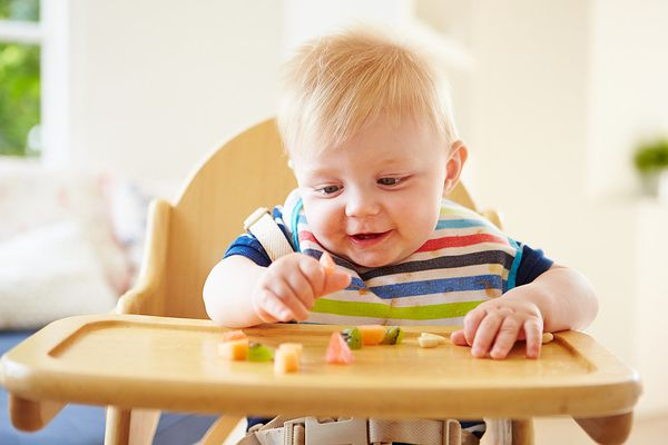 happy baby in high chair
