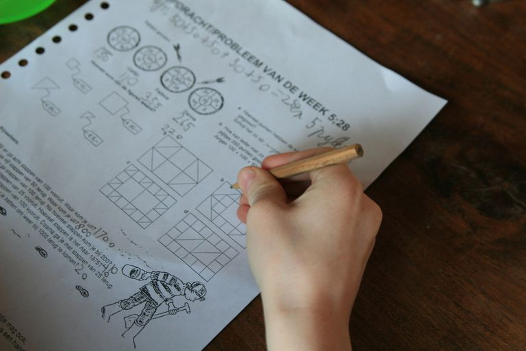Student doing homework, close-up